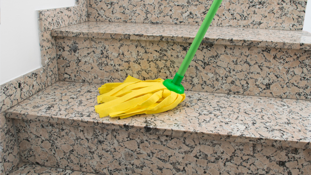 Using gentle cloth to clean granite