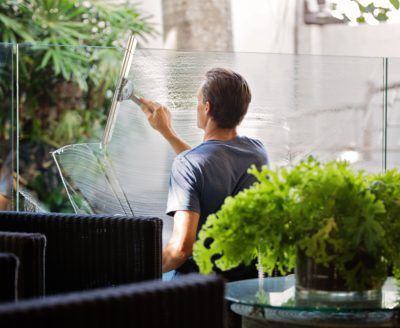Man Cleaning the Glass